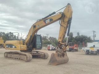 2010 Caterpillar 324 DL Excavator Photo