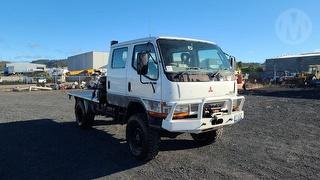 2003 Mitsubishi Canter FG649EWSRFAA 4WD MWB Dual Cab Chassis GVM 6,000kg Photo