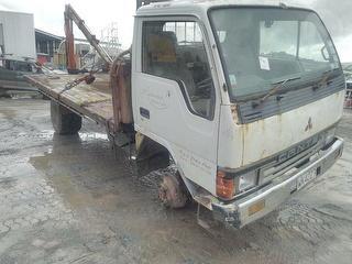 1989 Mitsubishi Canter FG437E Flat Deck Truck *** Whangarei *** Stolen & Recovered *** GVM 6,500kg Photo
